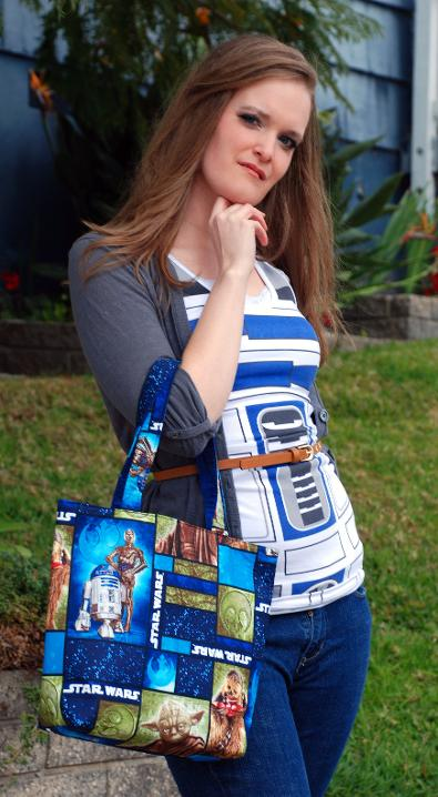Lindsey is carrying our Rebellion themed Star Wars Bag!